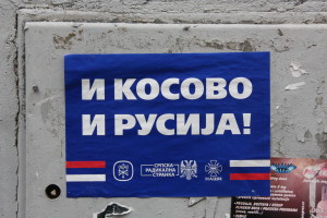 "Election poster in 2014, ""Both Kosovo and Russia,"" has the slogan of the far-right nationalist parties OBRAZ, Serb Radical Party and NASI. The anti-EU Serbian far-right seeks both Kosovo as part of Serbia, and orientation towards Russia. (Photographer: Raquel Torralba)"