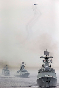 "Russia and China are currently conducting naval  exercises near Shanghai. In 2013, Russia and China conducted similar exercises near Vladivostok. From right, China's Yantai Type-054A missile destroyer, Yancheng Type-054A missile destroyer, Wuhan Type-052B guided missile destroyer and Lanzhou Type-052C air defence missile destroyer take part in the fleet review during the ""Joint Sea-2013"" Sino-Russian joint naval drills at the Peter the Great Gulf near Vladivostok in Russia on Wednesday, July 10, 2013. A Chinese fleet consisting of seven naval vessels participated in the ""Joint Sea-2013"" Sino-Russian joint naval drills scheduled for July 5 to 12. The eight-day maneuvers focus on joint maritime air defense, joint escorts and marine search and rescue operations. (Photo By Sheng Jiapeng/Color China Photo/AP Images)"