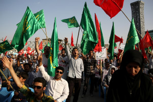 Iranians wave Islamic flags while chanting against the al-Qaida inspired Islamic State in Iraq and the Levant, ISIL, during a rally in central Tehran, Iran, Tuesday, June 24, 2014. (AP Photo/Ebrahim Noroozi)