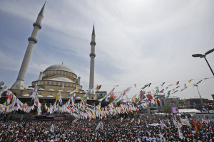 Supporters of Selahattin Demirtas, co-chair of the the pro-Kurdish People's Democratic Party (HDP) wait for him to arrive to deliver a speech during a rally in Istanbul, Turkey, Sunday, May 24, 2015. Turkey will hold general election on June 7, 2015. Although it is a relatively small party, all eyes will be on HDP. If it reaches the minimum 10 percent threshold required for entering parliament as a party, it could effectively thwart Turkey's President Recep Tayyip Erdogan's ambition to lead a presidential system following a constitutional change. (AP Photo/Emrah Gurel)