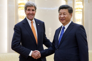 U.S. Secretary of State John Kerry, left, poses with Chinese President Xi Jinping prior to their meeting at the Great Hall of the People in Beijing, Wednesday, Jan. 27, 2016. Kerry is in China on the final leg in his latest round-the-world diplomatic mission. (AP Photo/Jacquelyn Martin, Pool)