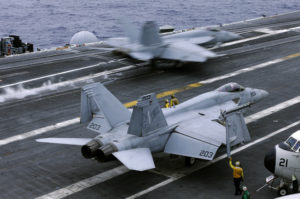 In this file photo from Wednesday, June 15, 2016, an F/A-18 Hornet takes off the deck of the nuclear-powered aircraft carrier the USS John C. Stennis during joint military exercise between the United States, Japan and India off the coast 180 miles east of Japan's southernmost island of Okinawa. The U.S. says at least one Chinese ship tailed the USS John C. Stennis daily during its recent cruise through the South China Sea, although no hostile incidents were reported. (AP Photo/Shizuo Kambayashi, File)