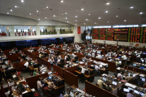 In this May 17, 2013 photo, trading continues at the Philippine Stock Exchange at the financial district of Makati city, east of Manila, Philippines. As the Philippine economy skyrocketed 7.8 percent in the first quarter, outpacing China, the middle class in the Southeast Asian nation that has been held back by widespread poverty, political strife and corruption is for the first time in decades reaping the profits of an economic boom. (AP Photo/Bullit Marquez)
